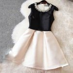 A-Line Round Neck Short Black and Pearl Pink Satin Homecoming Dress with Beading