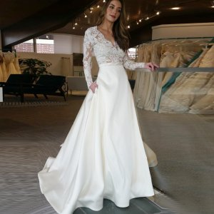 A-Line V-Neck Long Sleeves Sweep Train Satin Wedding Dress with Lace Pockets